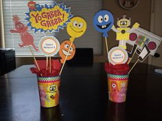 "Print YGG images from nickjr.com under ""party decorations"". Cut out and glue to skewers, place in cup. Instant centerpieces!"