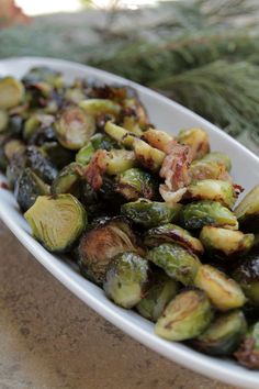 Brussels Sprouts with Roasted Garlic and Pancetta: Brussels sprouts are transformed in a wood fired oven when paired with roasted garlic and smoky pancetta. Don't miss this tasty side dish that really showcases this often-maligned vegetable.