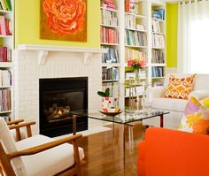 Colourful Living Room    In this design, a white painted fireplace and shelves pop against yellow walls, bold art and cozy chairs.