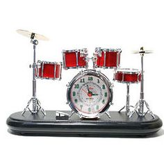 I used to have this Drumset Alarm Clock, but it was so loud...I think it died from pillow firing squad.