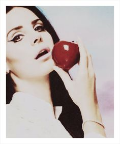 The most borderline special needs picture of Lana trying to be sexy. Don't eat that apple. Eating isn't sexy. Go home to have your hair like a house wife from a far side cartoon whenever you like, just not on my Internet.