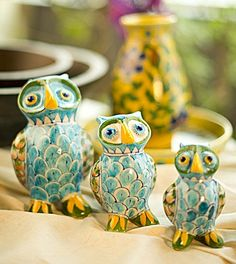 Create your personal menagerie with these artistic ceramic delights.     A set of three, each owl varies in size and has been hand painted with care.     Place them around your garden to keep a watch, on your study table as paper weights or as conversation pieces on your living room table.
