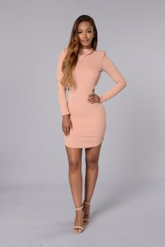 - Available in Burgundy and Blush - Mock Neck - Long Sleeve - Textured Fabric - Open Back - Made in USA - 97% Polyester 3% Spandex