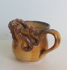 Cthulu mug? I must convince my brother to make this for me in his ceramics class!