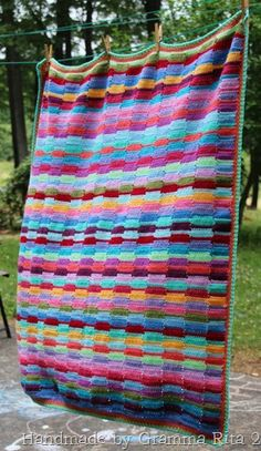 Ribbon blanket made by Gramma Rita. Free pattern by The Gingerbread Lady here http://gingerschatz.blogspot.ie/2010/10/pattern-ribbon-afghan.html