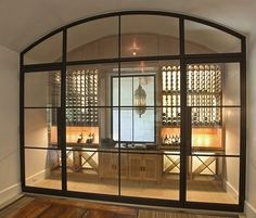 love the doors as dividers. would be great in basement too for a h… wine storage. love the doors as dividers. would be great in basement too for a home gym or music studio. home decor and interior decorating ideas. Style At Home, Cave A Vin Design, Home Wine Cellars, Wine Cellar Design, Wine Cellar Modern, Wine Wall, The Doors, Metal Doors, Glass Doors