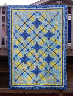 Starburst designed by Eileen Hoheisel of Pine Rose Designs. Her quilt is made using the Wing Clipper, V Block and Corner Beam. You can contact her at pvquilt@gmail.com or https://www.facebook.com/PineRoseDesigns.Patterns