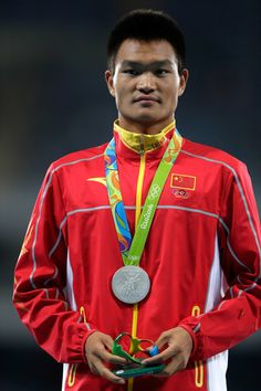 Zelin Cai of China poses with the silver medal for the Men's 20km Race Walk on Day 7 of the Rio 2016 Olympic Games at the Olympic Stadium on August 12, 2016 in Rio de Janeiro, Brazil
