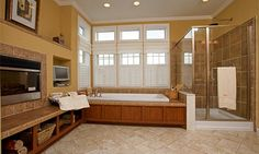 I would LOVE this bathroom. Heck, with a TV & fireplace, I'd never want to get out of that soaking tub! I'd turn into a prune!!