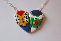 CharmingClayCreation: Woody and Buzz Lightyear Necklaces or Magnets - £10.00 @rinnybaby00 I think these two fit us more