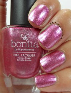 bonita nail lacquer polish in Truth Fairy- goes on wonderfully. seriously, you could get away with one coat. not the best shade for my skin tone, though. is a pink metallic polish, with subtle of shimmers throughout the polish. The formula is amazing and can easily be a one coater. However it was on the streaky side, so I applied another coat to level it. This is two coats, sealed with top coat.