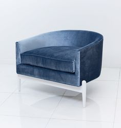 The Art Deco Chair in Serenity colored velvet is like no other chair we've created before. This sophisticated and unique seat sits staunchly over the solid walnut three leg base, and remains true to t