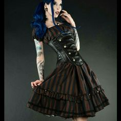 """Coming Soon! Steampunkabilly Dress A steampunk fabric in a rockabilly cut, made with super stretchy, forgiving fabric makes for a beautiful dress that'll make you look fab, corset or no. This doesn't come with petticoat or corset, so you should probably make a bundle.  L: Bust 32.5"""" - 42.5""""     Waist 26"""" - 38.5""""     Length 35.5 Boutique Dresses"""