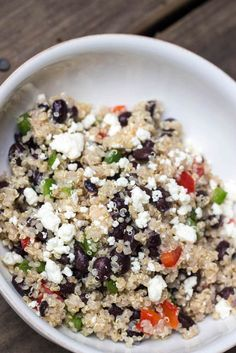 Summer means BBQs and this healthy black bean and feta quinoa salad is a perfect compliment to your cookout. It's quick and easy to make - less than 15 minu