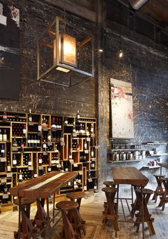 Love the tables & seating - Awesome wine bottle arrangement.