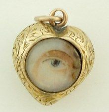 Lover's Eye in a heart-shaped gold locket.