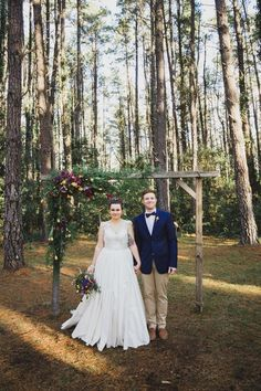 Winter Bride & Groom with Floral Ceremony Arch   Bliss Photography on @CVBrides via @aislesociety