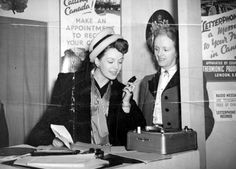 Actress Jean Kent records a Letterphone message on a vinyl record at the Canada Corner on the Overseas Mail stand at the 1948 Daily Mail Ideal Home Exhibition at Olympia