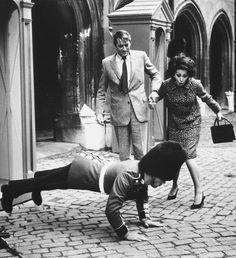 "gregorypeck: "" Gregory Peck and Sophia Loren watch a palace guard doing push ups. """