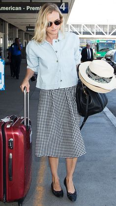 Diane Kruger never disappoints in the style department, and this was no exception. The actress donned a chambray button-down checked gingham skirt, quilted black flats, and a chic topper for her travels.