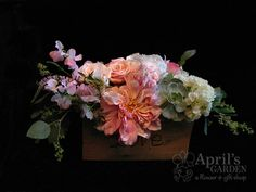 The groom made and did his own wood burning on these centerpiece boxes. They featured, sweet peas, dahlias, roses, hydrangea and succulents. Flowers by April's Garden, https://www.facebook.com/aprilsgiftgarden, http://durangoflorist.com/