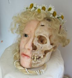 """SigridSarda - Vanité, The Maiden. A life-size waxwork mixed media sculpture. If you would like to get into the head of Sigrid Sarda, it may not be as easy as you would think. Her website states that she """"constructs life-size human figures made of wax incorporating human remains in the tradition of the doll as a magical object. The figures become talismans, reliquaries housing human bones."""""""