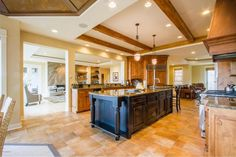 Lots of lighting & exposed wooden beams give this kitchen a warm and cozy vibe | Find details about 17294 Wood Drift Drive, West Olive, MI 49460  MLS#: 16016235  and similar real estate and homes for sale at Coldwell Banker.