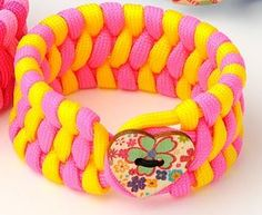 Paracord armband ladys pink/yellow via Saljbolaget.com. Click on the image to see more!