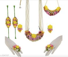 Jewellery Set  Gota Designed Jewellery Set Material: Gota Fabric Laces Foam Paper flower Size: Free Size  Ring : Free Size (Adjustable) Description: It Has 2 Piece Of Neckalce  1 Pair Of Bracelet  2 Piece Of Finger Ring  With 1 Pair Of Earring  Work: Gota Patti Country of Origin: India Sizes Available: Free Size   Catalog Rating: ★4.1 (1024)  Catalog Name: Diva Gota Designed Jewellery Sets Vol 3 CatalogID_462602 C77-SC1093 Code: 255-3341167-3741