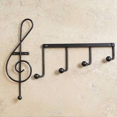 For musical people who love to have their home decor speak a bit more about themselves, these Music Note Hooks are a must-have in place of your boring coat racks.