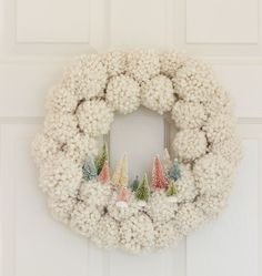 Simple, colorful ideas to decorate a little girl's room for Christmas. Includes tutorial for a bottle brush tree pompom wreath.