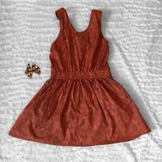 Urban outfitters orange backless dress Strapped cross int eh back and there is elastic waist for skirt portion. There is pockets as well! It does have a little bit of stretch as well! Brand urban renewal. Urban Outfitters Dresses