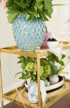 Who said you have to stick to cocktail glasses and liquor bottles when decorating a bar cart? Try integrating fresh greenery into the mix for a vibrant and natural look.