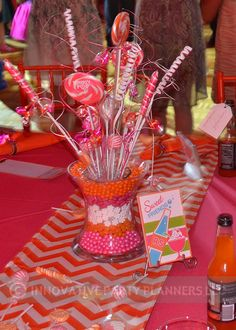Real candy centerpiece by Innovative Party Planners, for a sweet candy theme Bat Mitzvah featuring hot pink and orange candies. Order in any color combo.