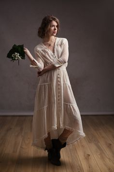 Stunning bohemian gauzy maxi dress with vintage laces all over. Front opening with mesh covered buttons. Thin elastic bands on the waist for better