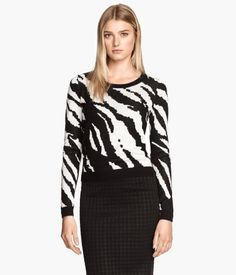 H&M: long sleeve print and solid color knit sweater with zip up back. Colors: black/white zebra print, back/white leopard print, dark purple solid color. This is a unique sweater with the long zip back. Sale Price: $19.95, Original Price: $34.95