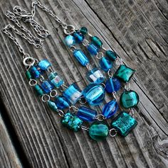 Three Tiered Blue Green Lamp Work Glass Necklace - pinned by pin4etsy.com