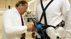 """Victor Gura fits a """"wearable artificial kidney,"""" which filters a patient's blood continuously."""