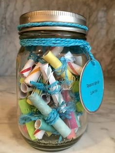 Roll up encouraging messages and tie them. Message Filled Mason Jar
