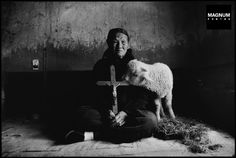 CHINA. Shaanxi Province. 1992. Han Ying Fang, 71 years old, is a fifth-generation Catholic in her family. During the Cultural Revolution, the Red Army raided Catholic homes, confiscating Bibles and other religious references. If the order was not obeyed during a given period, Catholics were severely punished at town meetings. At the time, when Hang Ying Fang's husband was still alive, he took the risk of hiding this crucifixion in the ceiling. It has survived until this day.