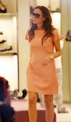 Peach shift dress, big gold watch. Victoria Beckham, simple, light and elegant.