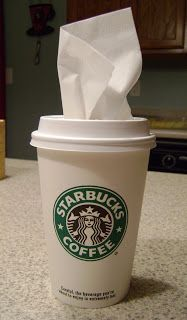 Mini tissue holder from a coffee cup--this would be perfect for the cup holder on the kids' booster seats