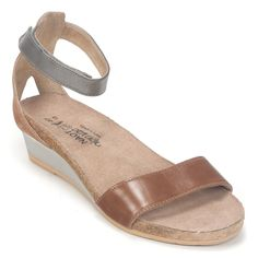 Naot Pixie is a stylish wedge sandal with contrasting leathers. This style features a hook and loop ankle strap for stability. Naot's anatomic cork & latex footbed is wrapped in a pampering suede and