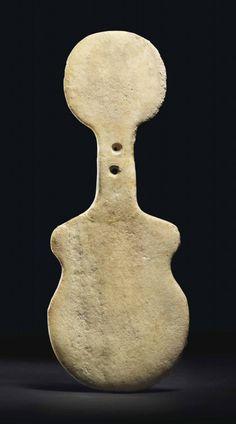 Anatolian Marble Idol, Kusura Type. Early Bronze Age II, circa 2700-2400 BCE. Christie's Antiquities Sale 8776, lot 29.