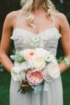 After seven years together this duo wanted their day under the sun and by the sea. The result? A relaxed coastal getaway at the hands ofEsoteric Eventscomplete with bouquets of lush Krista Jonblooms, etherealAmsalegowns, andgorgeous sequined La Tavolalinens. Set against