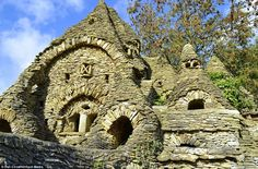 Hand-built: The farmer and artist said he started constructing the property - which features several turrets and dovecots - from stones he f...