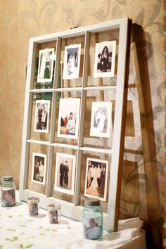 old window decor with parents & grandparents wedding photos surrounding us~I really like this idea, with any group of photos you love.