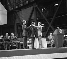 Astronaut Neil A. Armstrong receives the first Congressional Space Medal of Honor from President Jimmy Carter, assisted by Captain Robert Peterson. Armstrong, one of six astronauts to be presented the medal during ceremonies held in the Vehicle Assembly Building (VAB), was awarded for his performance during the Gemini 8 mission and the Apollo 11 mission when he became the first human to set foot upon the Moon.