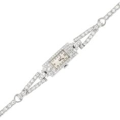 Platinum and Diamond Wristwatch  2 marquise-shaped & 97 single-cut diamonds ap. 2.10 cts., c. 1920, ap. 13.6 dwts. gross. Length 6 1/8 inches.