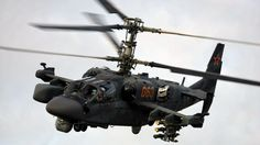 """The Kamov Ka-52K """"Katran"""" is a navalized version of Ka-52 to equip on board the Mistral class BPCs (French version of LPD/helo carriers). The Ka-52K benefits from folding blades and wings, a reinforced landing gear, anti-corrosion treatment, as well as new capabilities such as anti-ship. Unlike its counterpart the Ka-52 """"Alligator"""", the Ka-52K will carry the dual-band radar """"Arbalet"""" version with a Ka-band sensor (ground targets) and another X-band for marine targets.Will receive the…"""